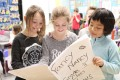 Grade 3 students at Tavistock Public School, from the left, Ella Spicer, Charlie MacLaughlin and Xin-En Tan, look over their class newspaper which is a compilation of stories and photos by all the students in Mrs. Nancy Marenger's class.