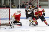 Braves' Kellen Gedies (#14) fights for position at the Paris net. The two teams went to game 7 on Tuesday night.