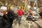 C.R. Plastic Products' Bruce Ballantyne (centre) explains the extruding process at the outdoor furniture plant in Stratford.