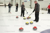 Brent Ropp (centre) and Brent Edmonstone discuss a shot at the Men's Curling Bonspiel on Saturday. Teammates behind are Matt Snyder (left) and Toby Schlegel.