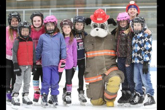 About 175 people enjoyed Family Day afternoon at the Tavistock Arena by Skating with Sparky the Fire Dog, sponsored by the Tavistock Fire Department. Hot dogs, cheese strings, chocolate milk, hats, crayons and colouring books were given away. Above, from the left are: Aubrey Shewchuk, Michael Buragina, Amylea DeVouge, Derika Scheerer, Tessa Gerber, Tori Burchatzki, Sparky (Ryan Ropp), Kylie Jackson, Bo Schurink (behind), and Connor Murray.