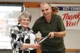 Ruthe Arnott receives her Community Achievement Award from EZT Councillor Jeremy Smith.
