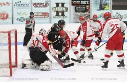#55 Derek Hyde fights for position in front of the Norwich Merchants' net. The Braves won 5-2.